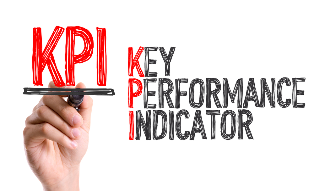 Hand with marker writing KPI-1