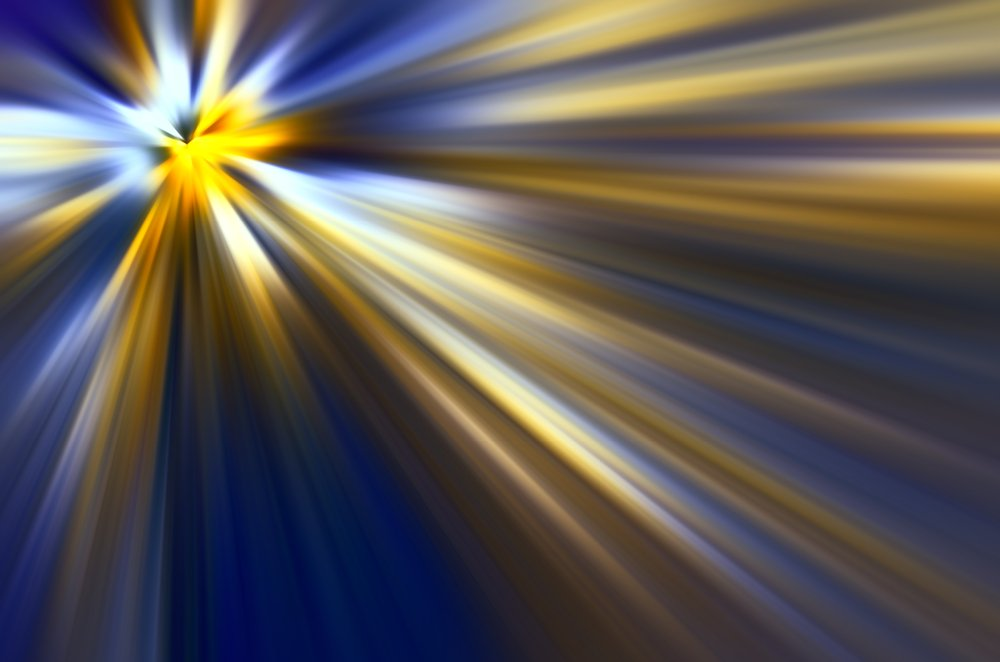 Multicolored abstract of mysterious origin, with radially blurred beams of light emitted by a source at upper left, for backgrounds with motifs of origin, revelation, illumination