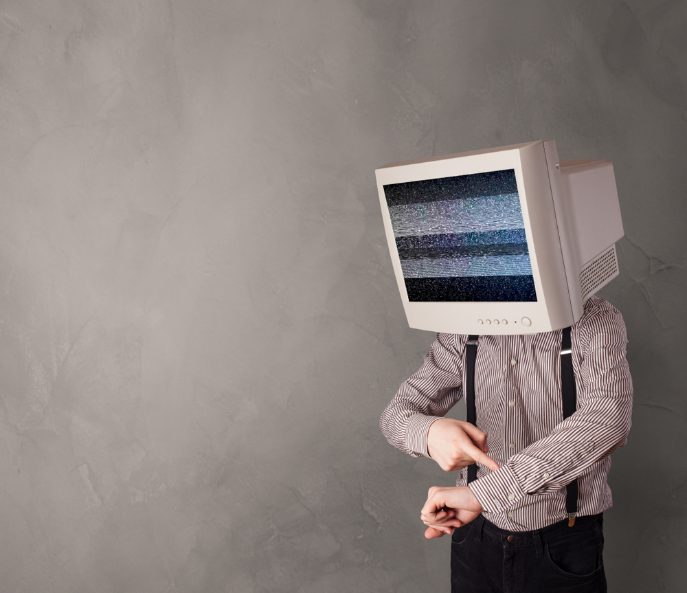 Young person with monitor head with no channel concept